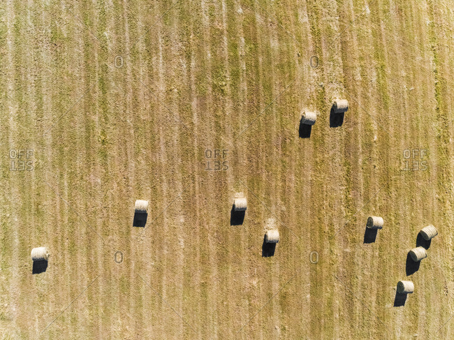 Abstract aerial view of straw bales in field in Correze, France.