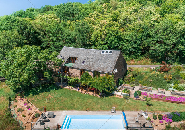Aerial view of traditional family home with pool in Correze, France.