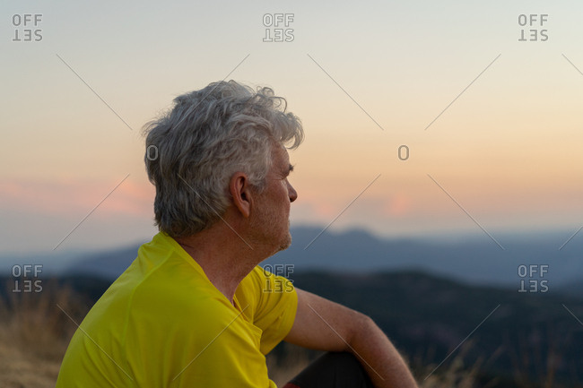 Elderly man relaxing in nature