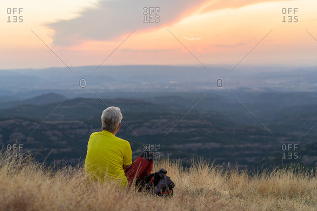 Elderly man relaxing in nature