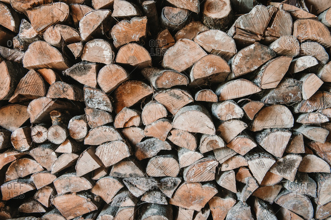 Textured background of pile of dry logs in countryside