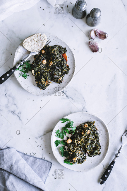 Plates with seaweed and spinach salad