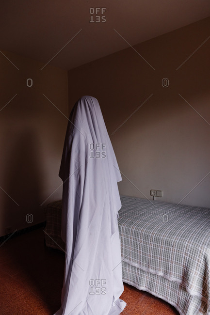 Person disguised as a ghost for Halloween