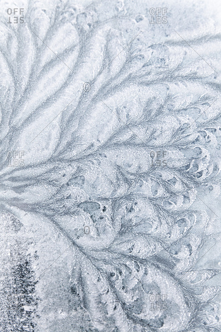 Abstract ice textures on a car window in winter