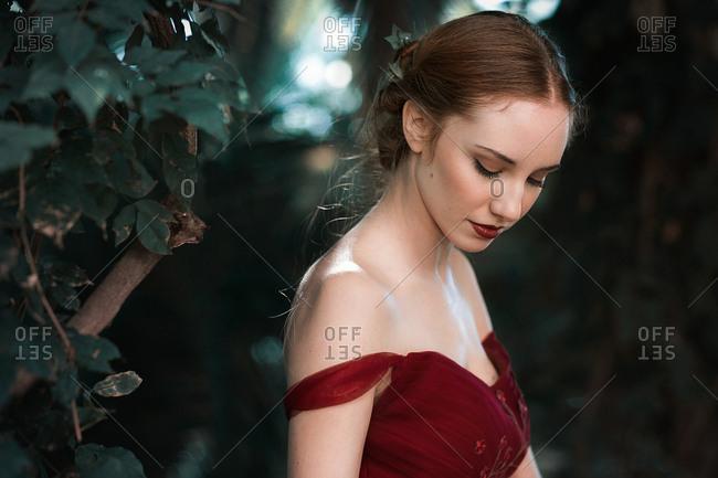 Elegant lady standing in garden