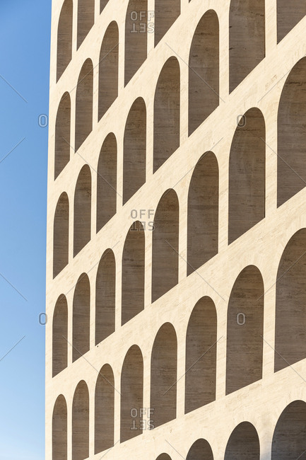 Rome, Italy - November 21, 2016: Exterior of a historic multi-story building, the Palazzo della Civilta Italiana, with arched windows