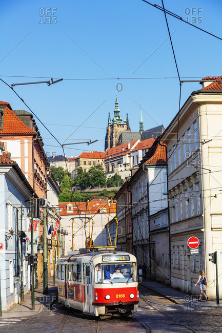 May 29, 2018: City tram, Prague Castle and St. Vitus Cathedral, Prague, UNESCO World Heritage Site, Bohemia, Czech Republic, Europe