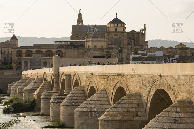 May 24, 2018: The Cathedral and Great Mosque of Cordoba (Mezquita) and Roman Bridge at twilight, UNESCO World Heritage Site, Cordoba, Andalucia, Spain, Europe