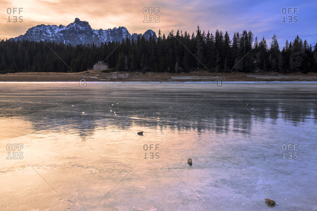 Colors of the sunset reflected on the icy surface of Lake Palu, Malenco Valley, Valtellina, Lombardy, Italy, Europe