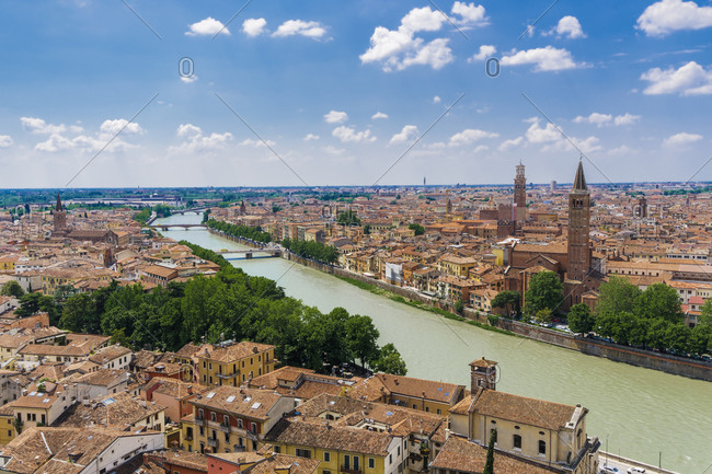 Adige River view with bridges, traditional buildings and church bell towers on river banks, Verona, Veneto, Italy, Europe