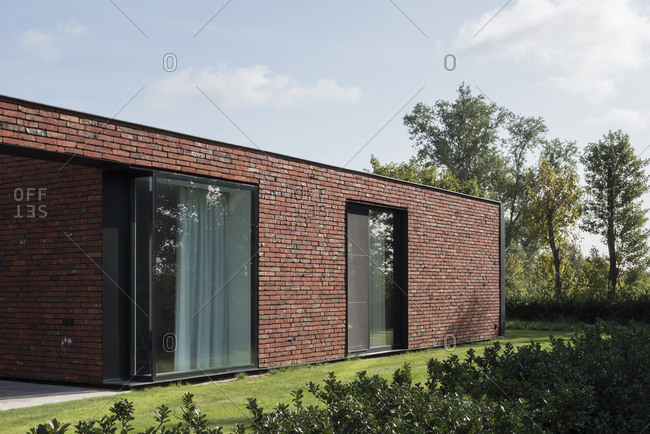 Modern brick house with tall windows