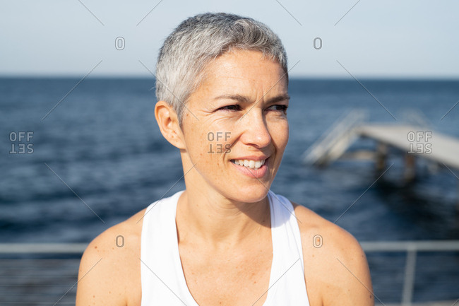 Portrait of a middle-aged woman by the sea