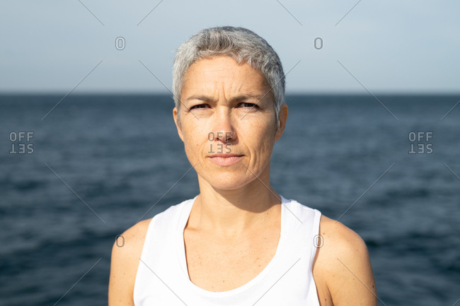 Portrait of a middle-aged woman standing by the sea