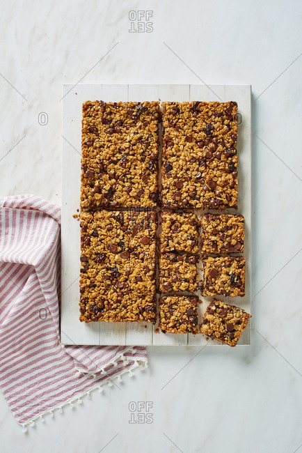 Homemade cereal granola bars on marble counter