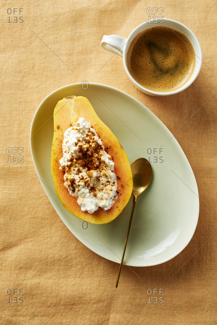 Single cut papaya stuffed with cottage cheese