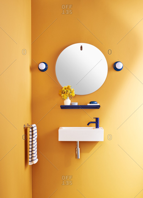 Bright orange bathroom with wall-mounted sink