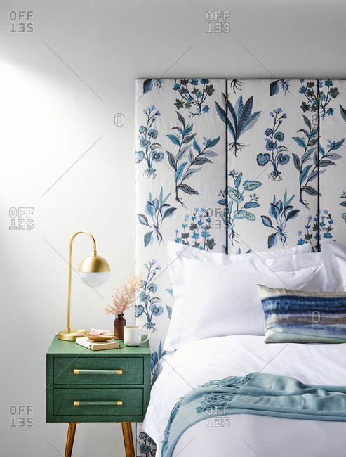 Upholstered floral headboard and fresh linens
