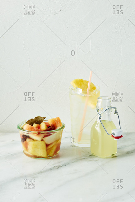 Fruit cup and fresh beverage in glassware