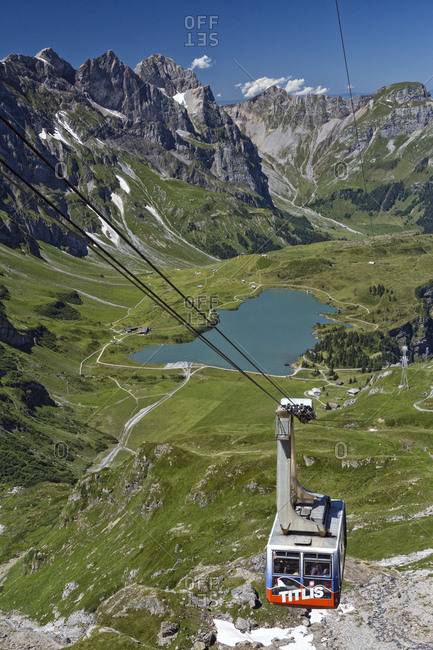 August 1, 2013: Titlis cableway and the Trubsee lake in the background, Engelberg, Canton of Obwalden, Switzerland, Europe
