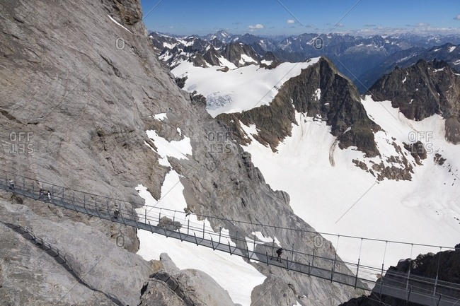 Aerial view of tourists in the Titlis Cliff Walk, the Europe's highest suspension bridge, Engelberg, Canton of Obwalden, Switzerland, Europe