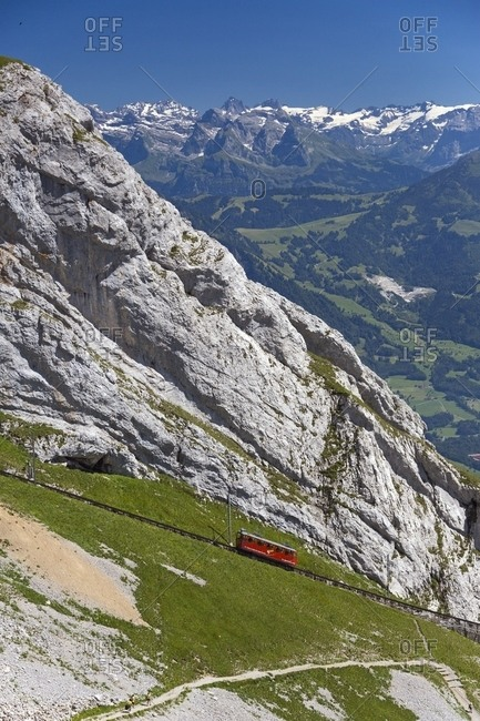August 2, 2013: The red Cogwheel Railway going up Pilatus Mountain, Border Area between the Cantons of Lucerne, Nidwalden and Obwalden, Switzerland, Europe