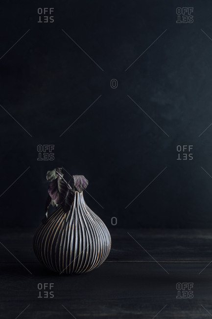 Vase with dried leaves