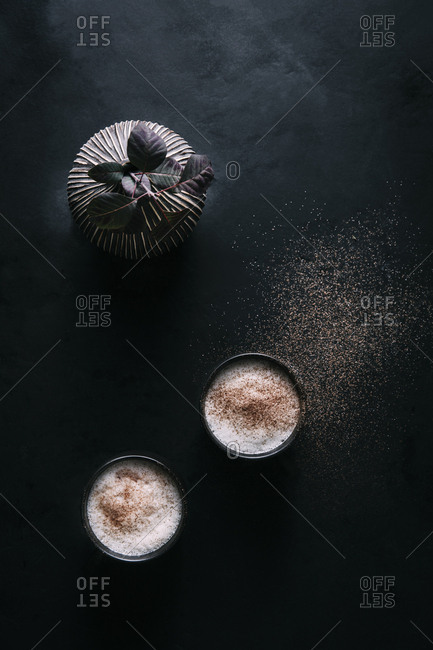 Overhead of two chai lattes
