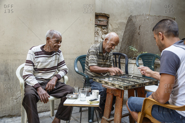 October 22, 2017: Men playing backgammon at the old city, Acre (Akko), Israel.