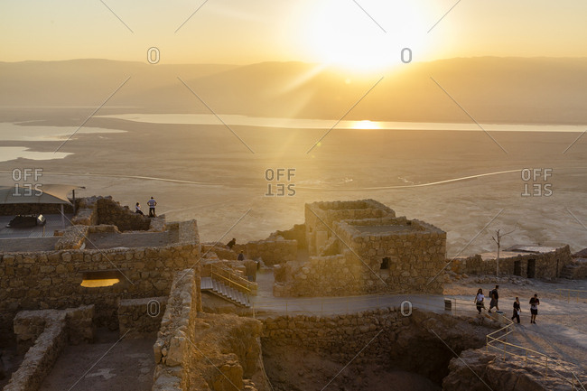 October 26, 2017: People at Masada fortress looking at the sunrise over the Dead Sea, Israel.