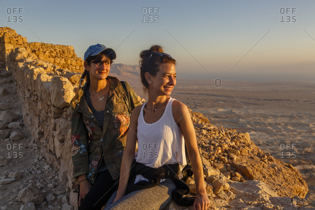 October 26, 2017: Young women at Masada fortress at the edge of the Judean Desert, Israel.