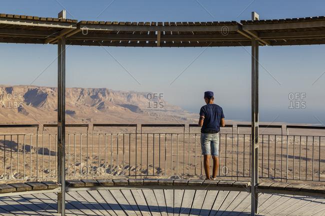 Young man (Shalem Anaki) praying at the Masada fortress at the edge of the Judean Desert, Israel.