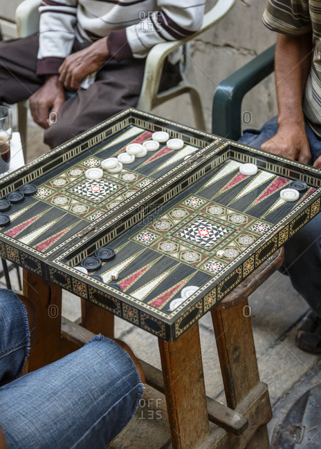 Men playing backgammon at the old city, Israel.