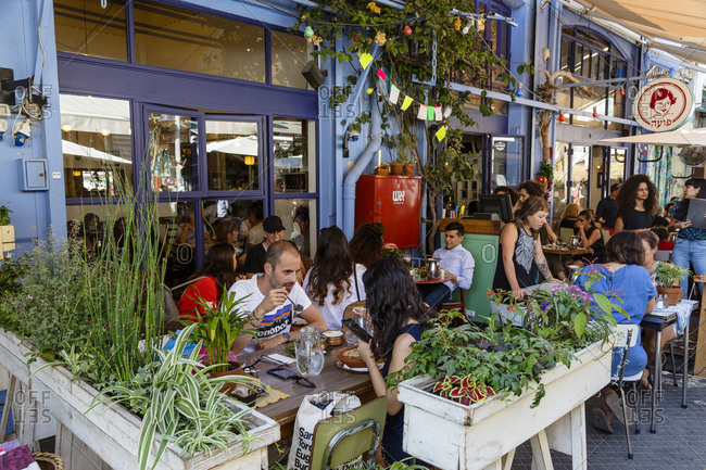 October 24, 2017: People sitting at Poa Restaurant & Cafe, Jaffa Flea Market, Tel Aviv, Israel.