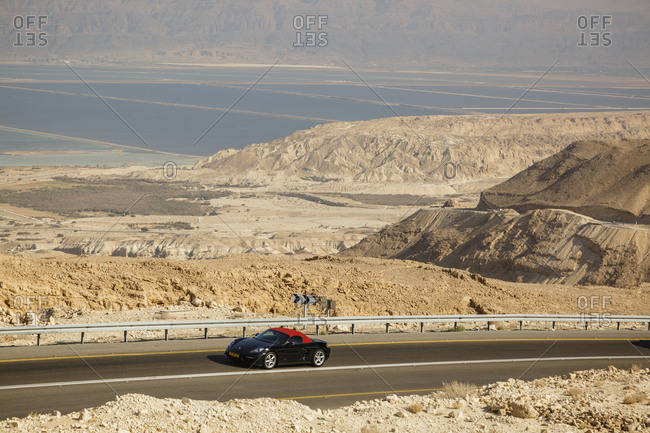 October 26, 2017: Sports car on the Sdom-Arad road in the Negev desert, Israel.