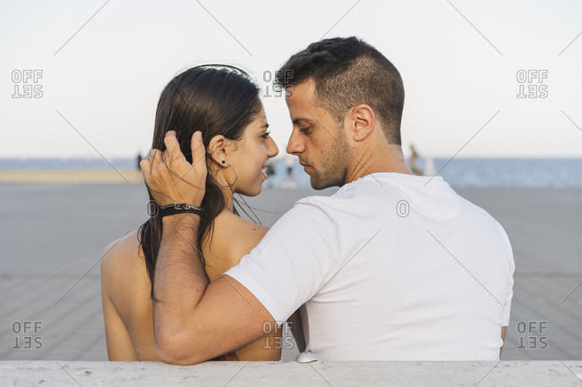 Young urban couple falling in love- kissing