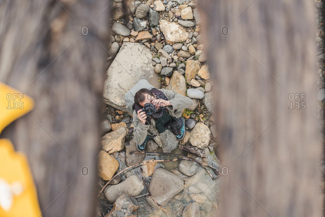 Man taking photo with camera outdoors- top view