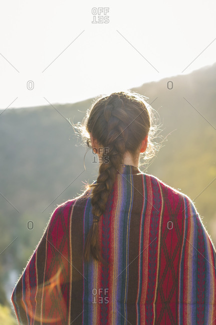 Spain- Alquezar- back view of woman with braid at backlight