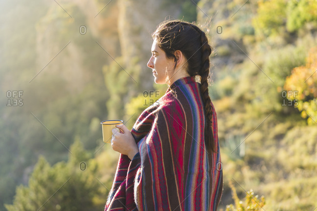 Spain- Alquezar- young woman with coffee mug in nature