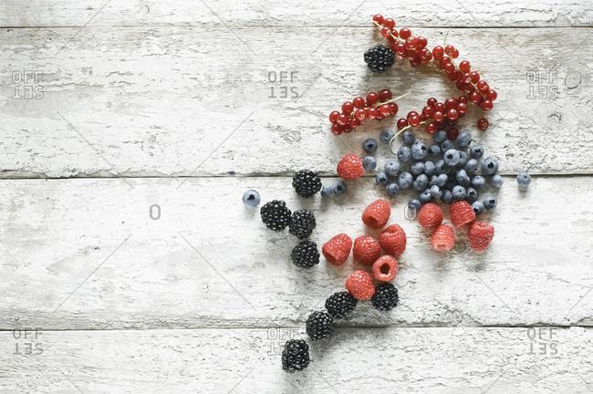 Various berries on wood