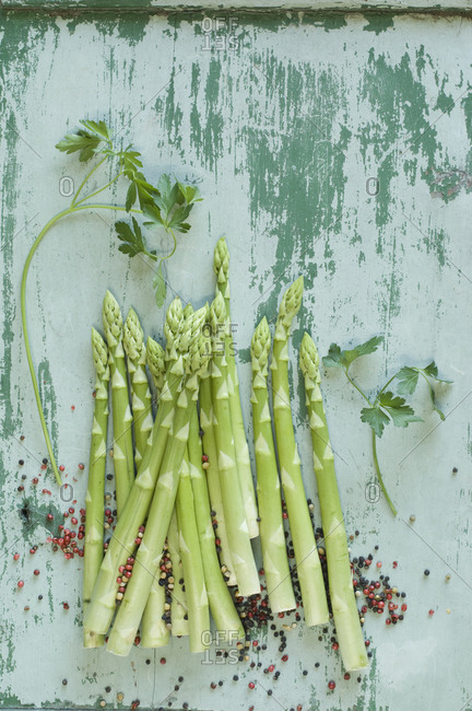 Raw green asparagus spears- parsley  and mixed peppercorns