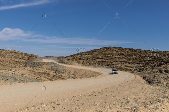 Africa- Namibia- Namib desert- Naukluft National Park- off-road vehicle on gravel road