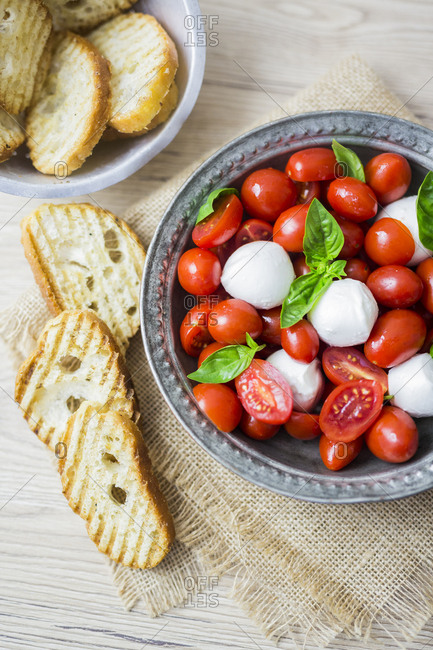 Italian food- caprese- mozzarella and tomatoes and basil