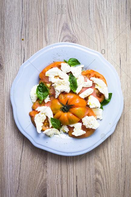 Italian food- caprese- mozzarella and tomatoes and basil