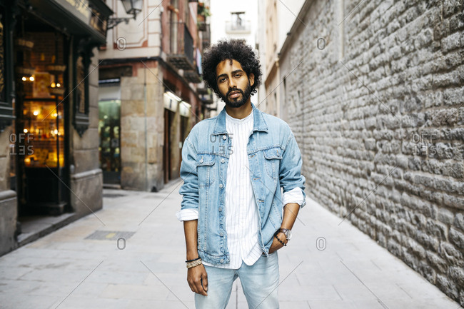 Spain- Barcelona- portrait of bearded young man with curly hair