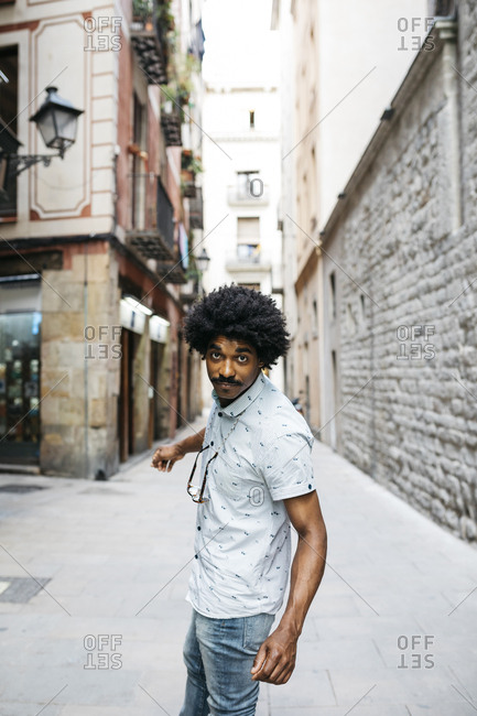 Spain- Barcelona- portrait of man with moustache and curly hair