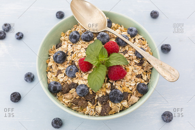 Bowl of muesli with raspberries and blueberries