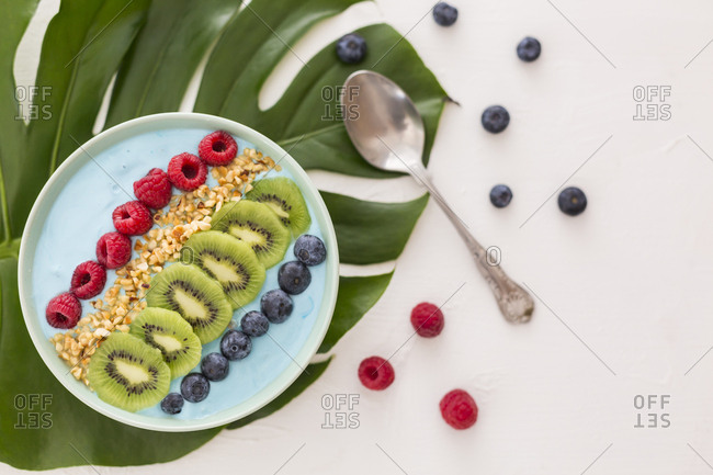 Smoothie bowl with blueberries- raspberries- kiwi and chopped hazelnuts