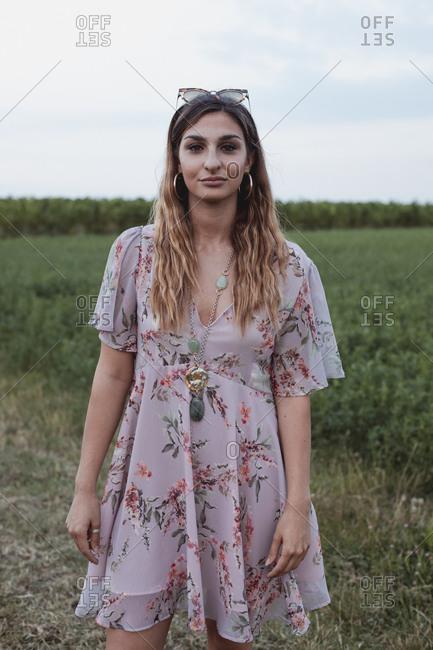 Woman standing in field- wearing summer dress
