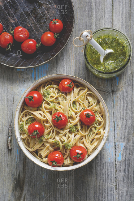 Homemade whole-grain ribbon noodles with pesto and cherry tomatoes