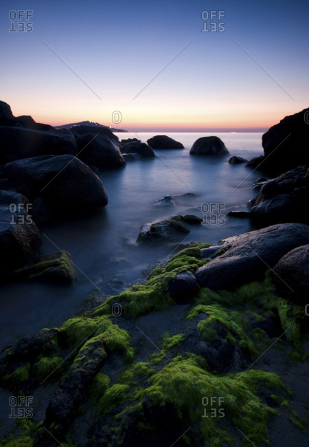 Italy- Sardinia- rocky coast at blue hour